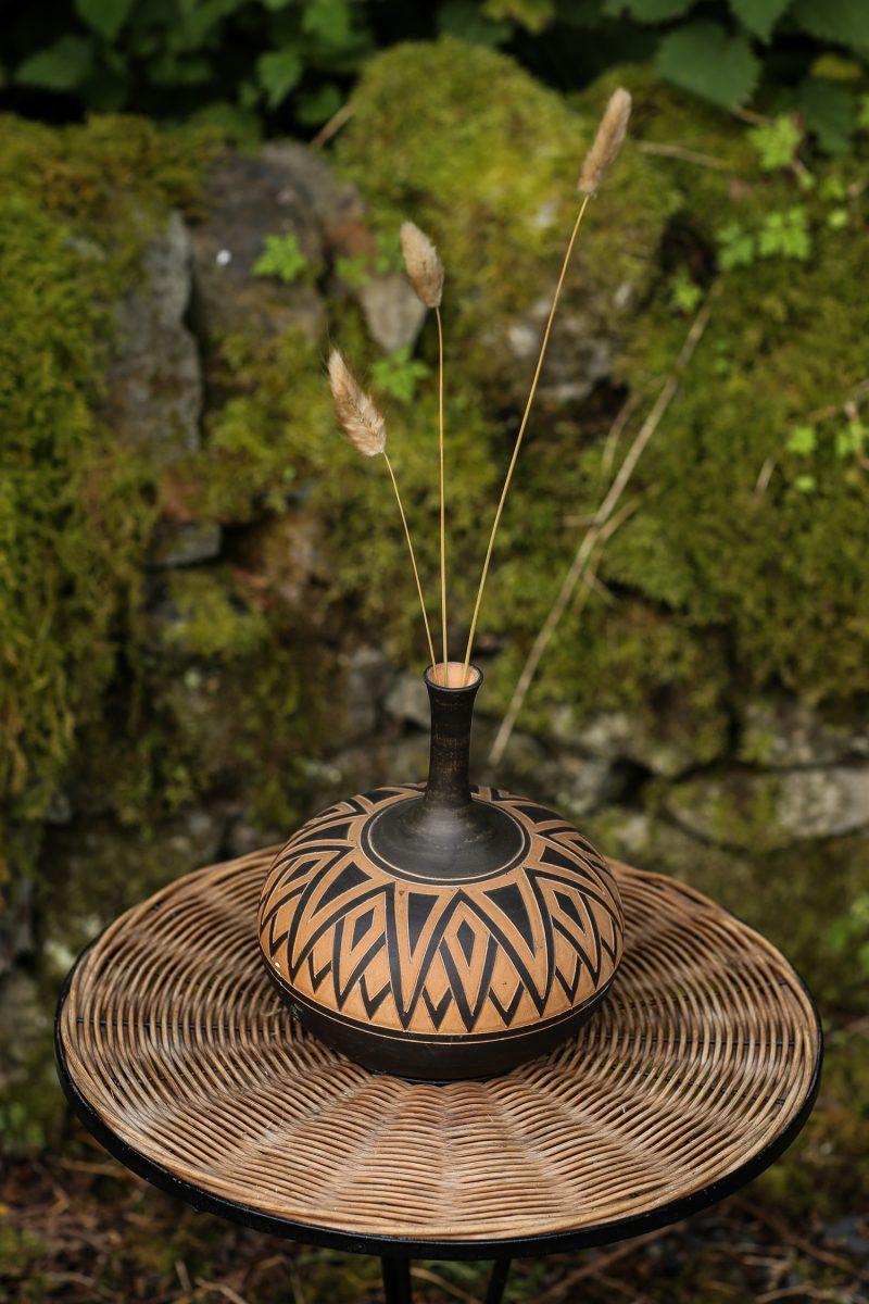 Terracotta Vase on Rattan Table