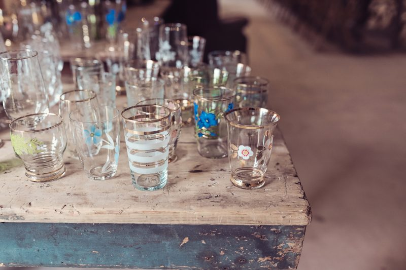 Water glasses on rustic workbench
